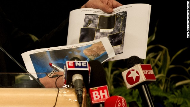 Malaysian Minister of Defence and Acting Transport Minister Hishammuddin Hussein shows pictures of possible debris during his statement on the missing Malaysia Airlines flight MH370 at the Putra World Trade Center (PWTC) in Kuala Lumpur on March 26, 2014. Malaysia drew criticism on March 25 for its announcement that the missing passenger jet had been lost at sea, even before any wreckage was found. AFP PHOTO / MOHD RASFAN (Photo credit should read MOHD RASFAN/AFP/Getty Images)