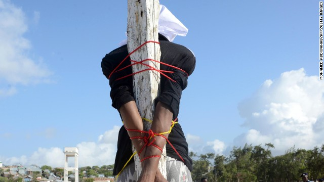 Convicted murderer Adan Sheikh Abdi is tied to a post before being executed by firing squad in August, 2013 in Somalia.