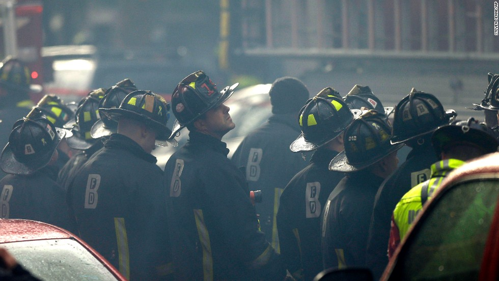 Firefighters watch the blaze.