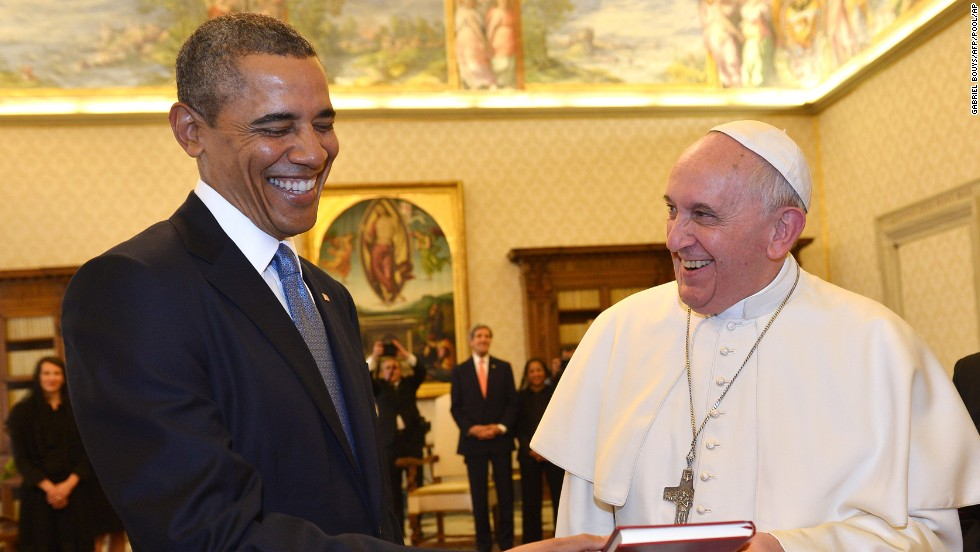 U.S. President Barack Obama and Pope Francis exchange gifts in the Pope's private library at the Vatican on Thursday, March 27. It was their first-ever meeting.
