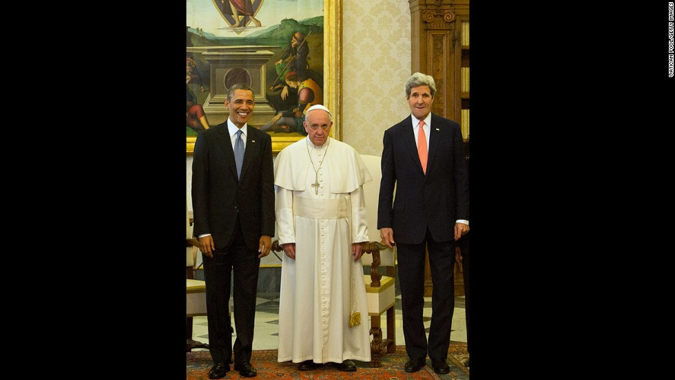 Obama and Secretary of State John Kerry pose with the Pope at his private library in the Apostolic Palace.