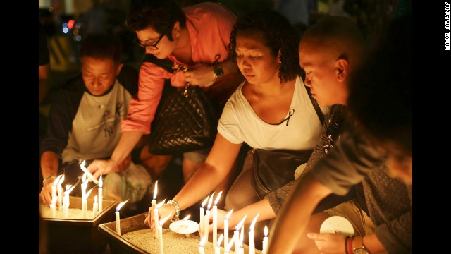 People light candles during a ceremony in memory of passengers on board the missing flight in Kuala Lumpur, Malaysia, on March 27.