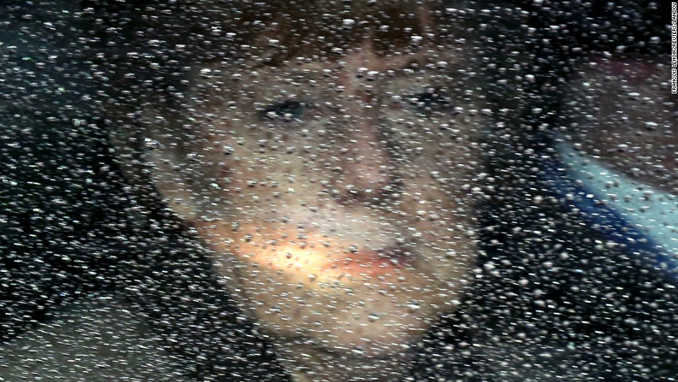 German Chancellor Angela Merkel looks through her window as she arrives at a European Union summit in Brussels, Belgium, on Friday, March 21.