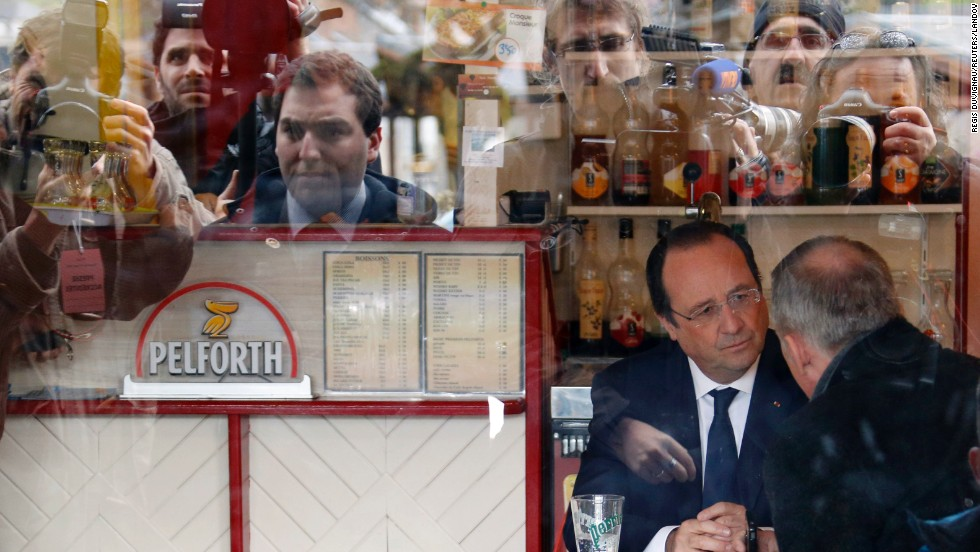 French President Francois Hollande is seen in a bar after voting in the first round of mayoral elections in Tulle, France, on Sunday, March 23.