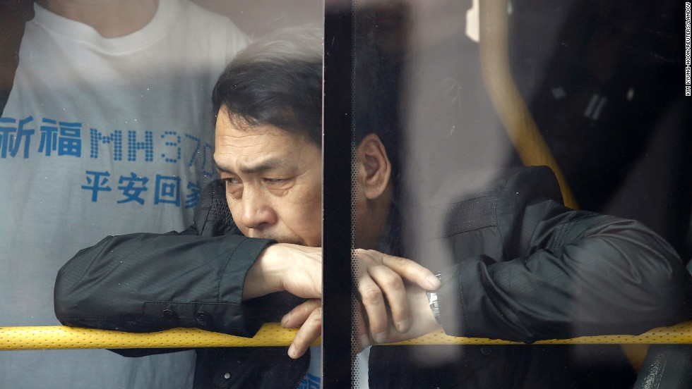 "A family member of a passenger aboard <a href=""http://www.cnn.com/2014/03/07/asia/gallery/malaysia-airliner/index.html"">Malaysia Airlines Flight 370</a> waits on a bus before heading to the Malaysian Embassy in Beijing on Tuesday, March 25. A day earlier, the Malaysian Prime Minister announced that that the missing flight ended in the southern Indian Ocean, according to an analysis of satellite data."