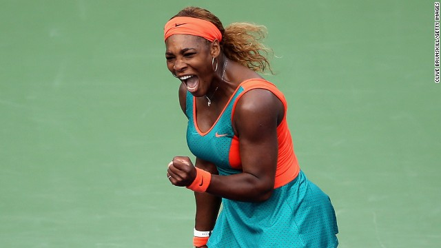 Serena Williams punches the air in delight during her semifinal match-up with Russia's Maria Sharapova.