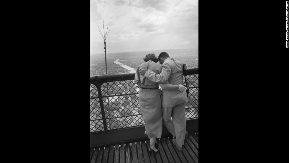 A couple enjoys the view from the Eiffel Tower in 1952. More than 250 million visitors have been to the tower since its construction in 1889.