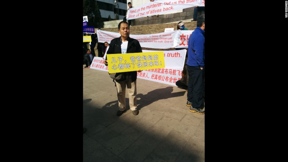 """Saturday morning at family demo outside Lido Hotel, Mr. Wen, father of a MH370 passenger, holding this banner: 'Son, mum & dad's hearts are torn to pieces. Come home quickly!""  By CNN's Yuli Yang, Beijing, March 29.  Follow Yuli on Instagram at <a href=""http://instagram.com/macchax"" target=""_blank"">instagram.com/macchax</a>."