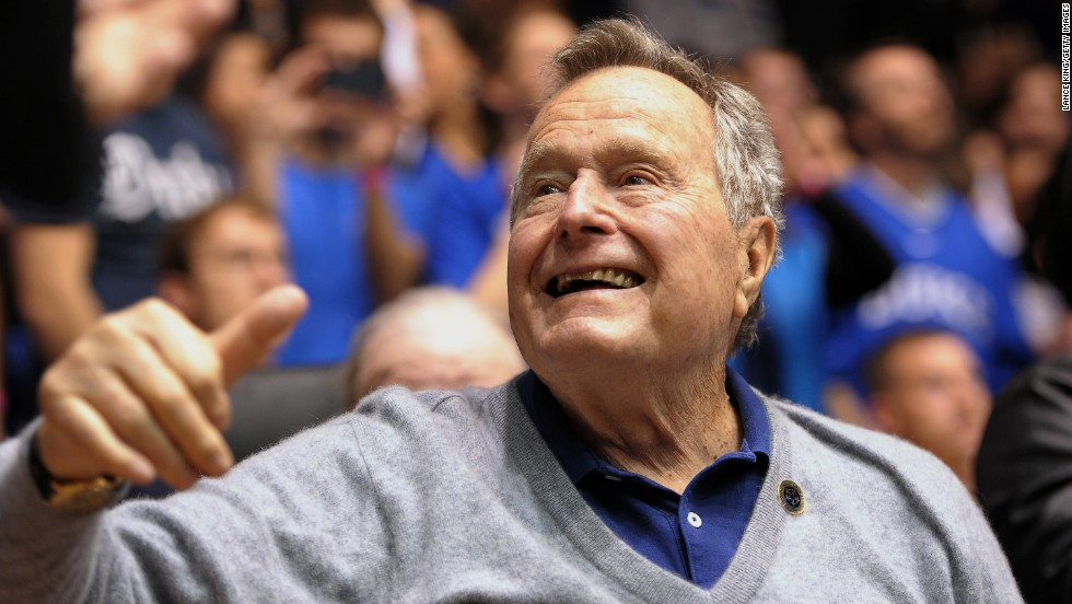 Former President George H.W. Bush attends a college basketball game between North Carolina State and Duke in Durham, North Carolina, on January 18, 2014. Click through the images to see Bush's life in pictures.