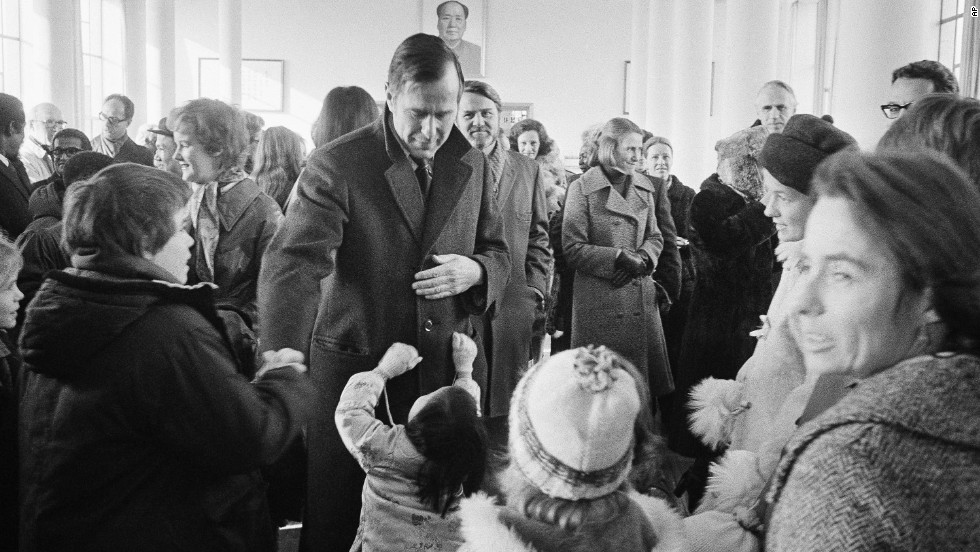 Under President Gerald Ford, Bush served as the chief liaison to China in 1975. Here, Bush greets well-wishers in Beijing.
