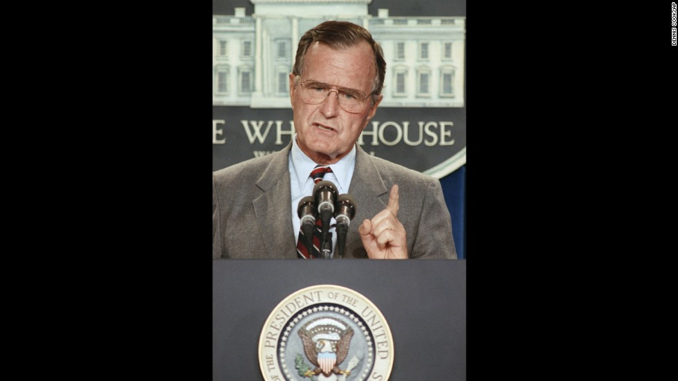 Bush holds a White House news conference in August 1990 during the run-up to war with Iraq.