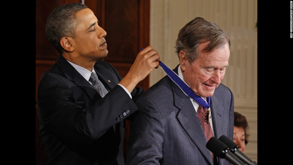 President Barack Obama presents Bush with the 2010 Medal of Freedom in February 2011 at the White House.