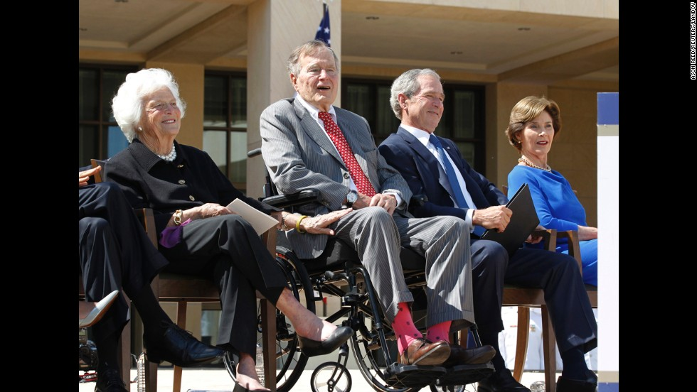 Bush wears socks featuring the American flag at the dedication ceremony for his son's presidential library in Dallas in April 2013.