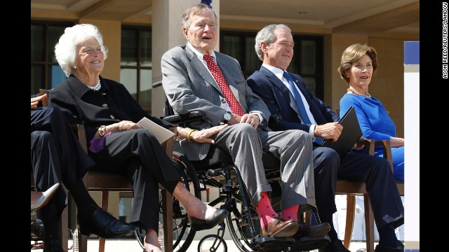 Former U.S. President George H.W. Bush (2nd L) wears pink socks as he attends the dedication ceremony for the George W. Bush Presidential Center in Dallas, April 25, 2013. Also pictured are former first lady Barbara Bush (L), former President George W. Bush (2nd R) and former first lady Laura Bush. REUTERS/Jason Reed (UNITED STATES - Tags: POLITICS) Reuters /JASON REED /LANDOV   Photographers/Source: JASON REED/Reuters /Landov