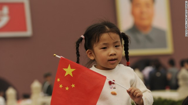 A young girl holds a Chinese flag in front of Tiananmen Gate in Beijing on China National Day on October 1, 2010. Thousands gathered on the square to mark the 61st anniversary of the founding of the People's Republic of China. AFP PHOTO/Peter PARKS (Photo credit should read PETER PARKS/AFP/Getty Images)
