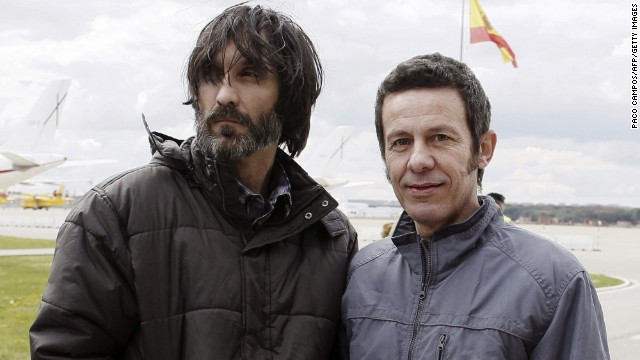 El Mundo correspondent Javier Espinosa, right, and freelance photographer Ricardo Garcia Vilanova arrive at the military airbase in Torrejon de Ardoz, near Madrid, on March 30, 2014.