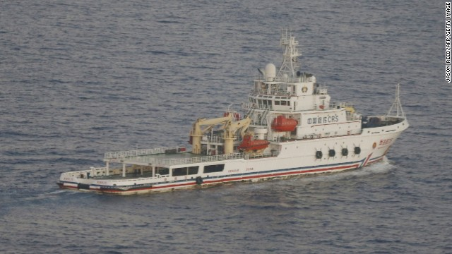 The Chinese ship Nan Hai Jiu is pictured in the southern Indian Ocean from the flight deck of a Royal New Zealand Air Force P-3K2 Orion aircraft searching for missing Malaysian Airlines flight MH370, on March 29, 2014. Chinese ships trawled a new area in the Indian Ocean for a missing Malaysian passenger jet on March 29, as the search for Flight MH370 entered its fourth week amid a series of false dawns over sightings of debris.