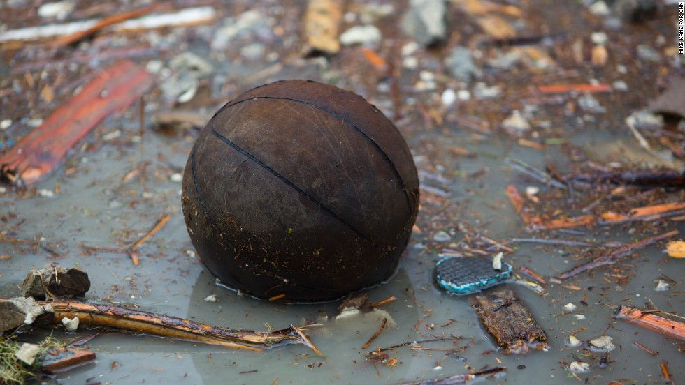 A basketball floats on floodwaters.