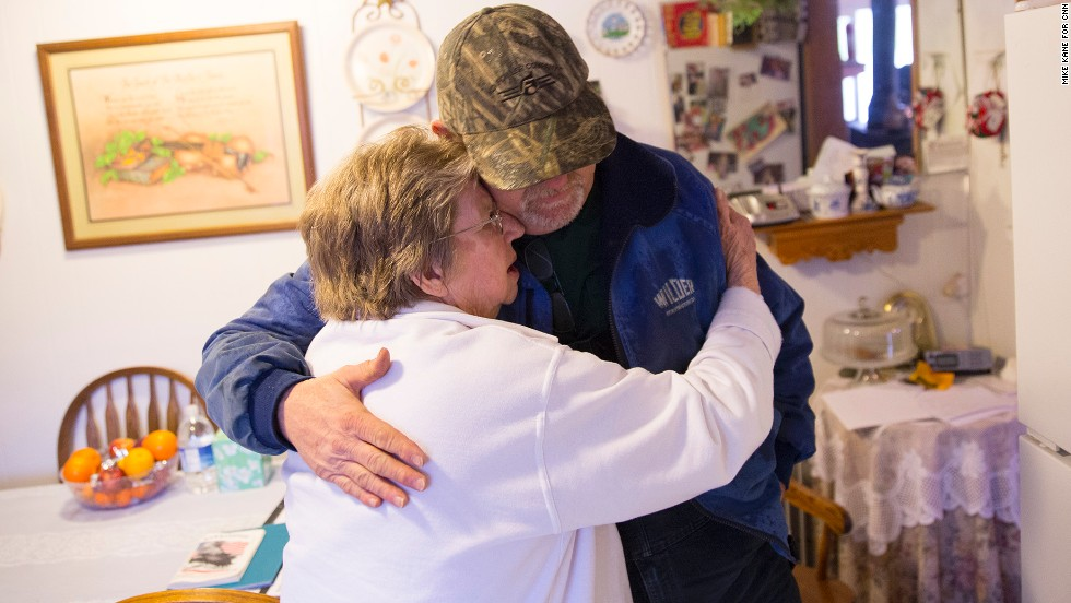 Mike Cabe hugs his mother, Janet, at her house in Darrington. Janet, 82, prepared food for firefighters and other volunteers.