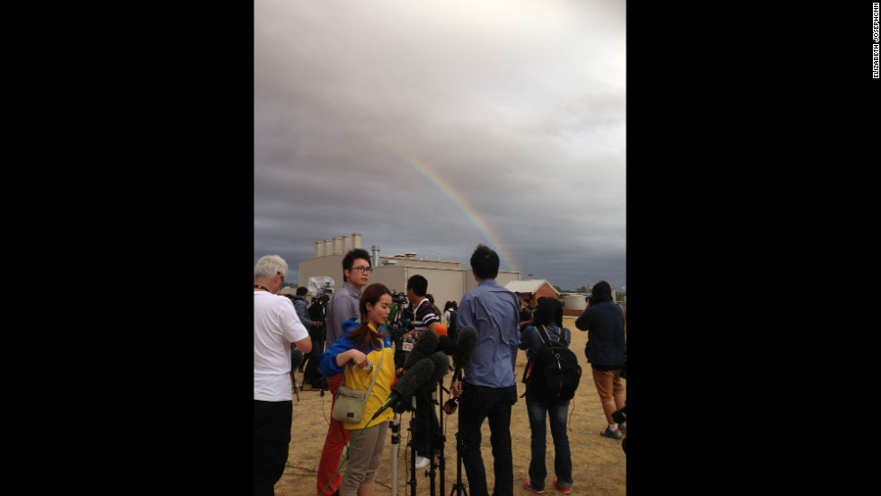 """As the media sets up their cameras and mics to film the first Australian P3 return to the airbase from search on March 29, a rainbow pokes out from behind the clouds.""  By CNN's Elizabeth Joseph at RAAF Base Pearce, March 29.  Follow Elizabeth on Instagram at <a href=""http://instagram.com/ejo1224"" target=""_blank"">instagram.com/ejo1224</a>."