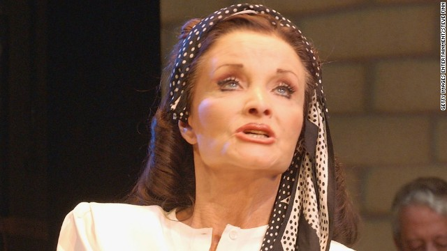"Kate O'Mara performs in a 2004 production of ""We Happy Few."""