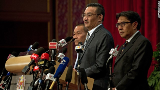 Malaysian Defence Minister Hishammuddin Hussein (2nd R) delivers a statement on missing Malaysia Airlines flight MH370 to the media at the Putra World Trade Center (PWTC) in Kuala Lumpur on March 31, 2014.