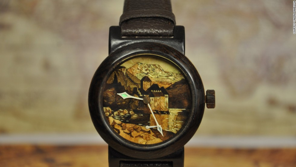 "In contrast, this delicate wooden watch by self-taught watchmaker Valerii Danevych, named ""Chillon Castle"", features a marquetry-decorated dial which hides a Swiss-made movement."