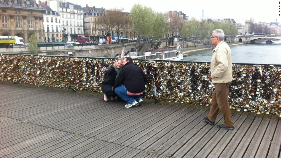 Couples often head to Paris's Pont des Arts bridge to attach padlocks as a symbol of their love.