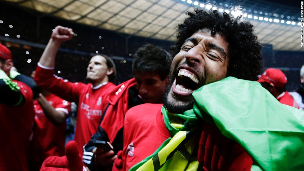 Dante of Munich celebrates after the Bundesliga match between and Hertha BSC and FC Bayern Muenchen at Olympiastadion on March 25, 2014 in Berlin, Germany.