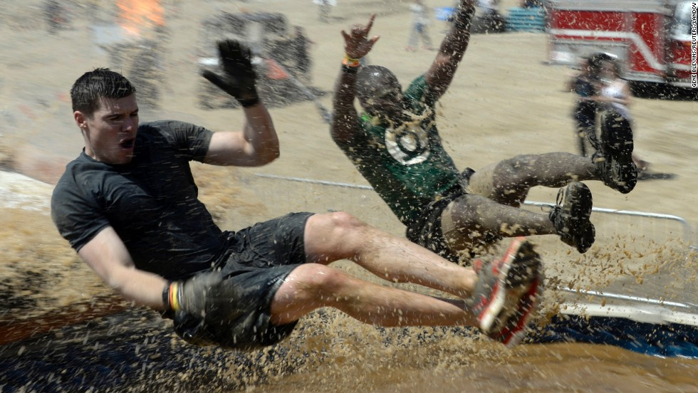 Competitors hit muddy water at full speed during the Tough Mudder obstacle race in San Bernardino, California, on Saturday, March 29.