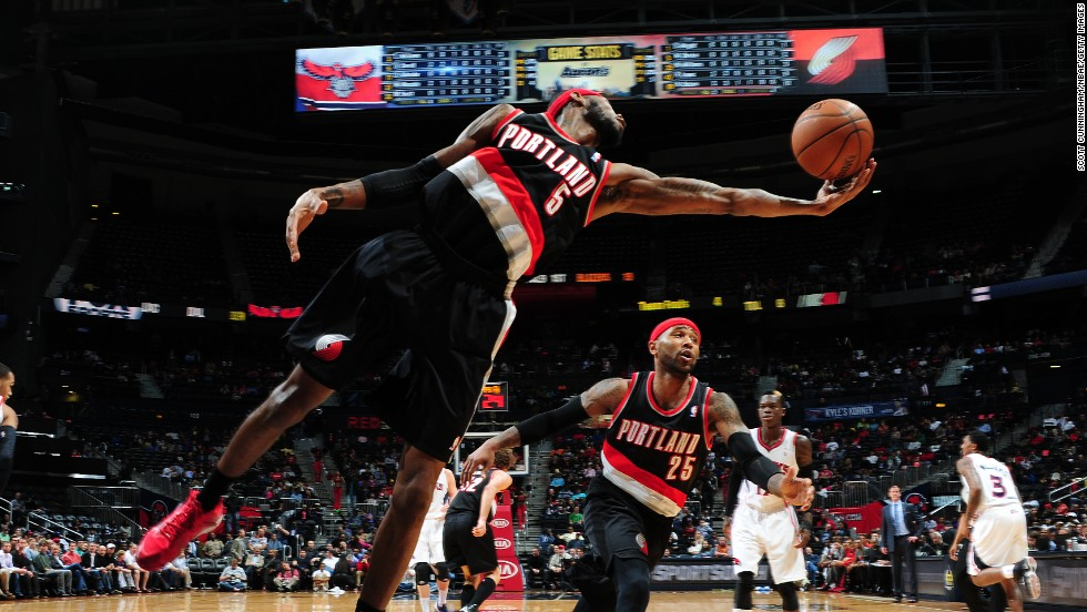 Portland's Will Barton stretches for a loose ball during an NBA game in Atlanta on Thursday, March 27.