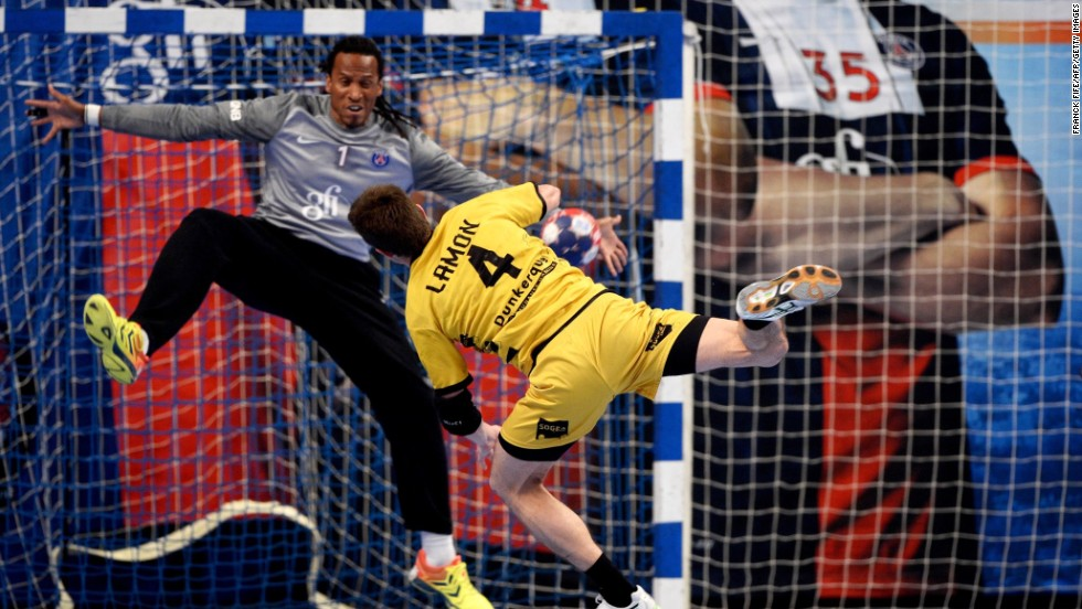 Dunkerque's Bastien Lamon scores in a French League handball match against Paris Saint-Germain on Thursday, March 27, in Paris.
