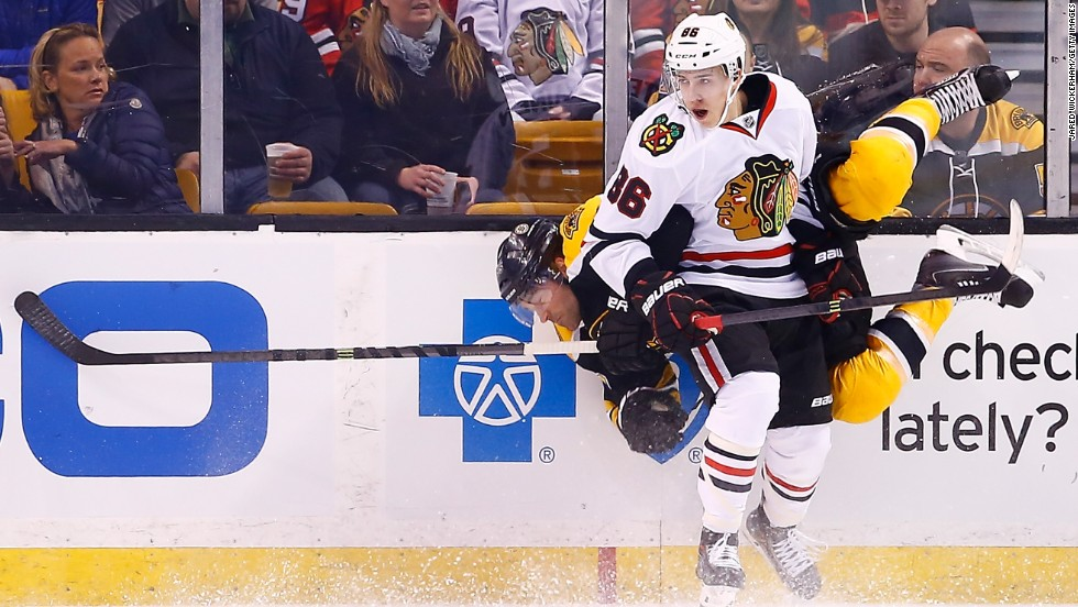 Chicago's Teuvo Teravainen, front, collides with Boston's Johnny Boychuk during an NHL hockey game in Boston on Thursday, March 27.