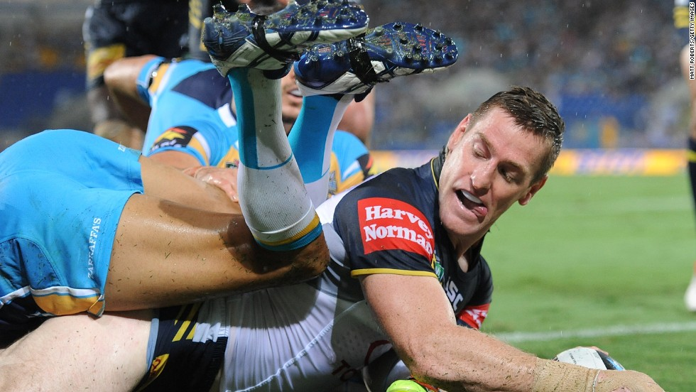 Brent Tate of the North Queensland Cowboys scores a try, later denied by the video referee, during a rugby league match against the Gold Coast Titans on Monday, March 31, in Gold Coast, Australia.