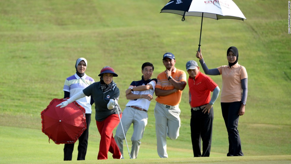 The Queen of Malaysia watches her shot during a pro-am event that was held Wednesday, March 26, prior to the EurAsia Cup in Kuala Lumpur, Malaysia.