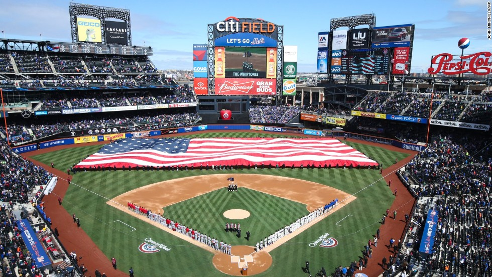 A giant American flag is unfurled at Citi Field in New York before a Major League Baseball game between the New York Mets and Washington Nationals on Monday, March 31.