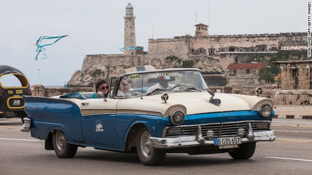 Tourists travel in a taxi, on January 8, 2014 in Havana. Cuban lawmakers approved an international investment measure.