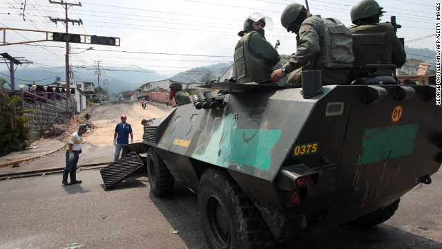Security forces stand guard as barricades set by anti-government demonstrators are being cleared, in San Cristobal, Venezuela, on March 31, 2014. Venezuelan security forces have cleared barricades from San Cristobal, the western city that launched the first in a wave of national anti-government protests, a military commander said Monday.The San Cristobal protest inspired demonstrations in other parts of the country against President Nicolas Maduro, demanding solutions to the country's violence, food shortages and soaring inflation. Protesters have also demanded the release of jailed protesters. The protests have often turned violent, leaving at least 39 people dead. AFP PHOTO/GEORGE CASTELLANO (Photo credit should read George CASTELLANO/AFP/Getty Images)