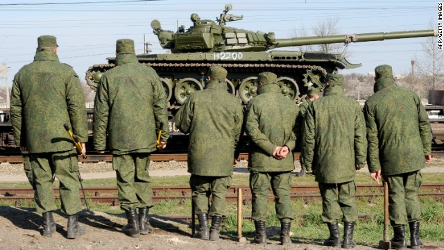 Russian soldiers unload trainload of their modified T-72 tanks after their arrival in Gvardeyskoe railway station near the Crimean capital Simferopol, on March 31, 2014.