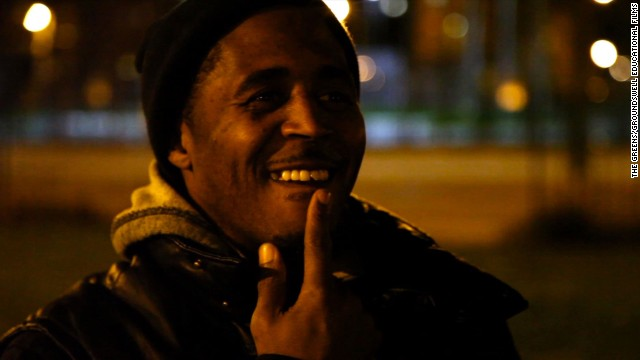 Williams shows his chipped tooth from running races with other kids inside Chicago's infamous Cabrini Green high rise.