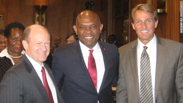 Tony O. Elumelu (center) with Senator Chris Coons (left) and Senator Jeff Flake on March 27.