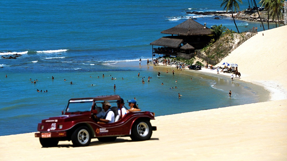 "A 15-minute drive north of Natal, the capital of Rio Grande do Norte state, Genipabu is best known for the buggy and camel rides available within the dunes and lagoons. The dunes are always changing, shaped and carved by strong winds along the Rio Grand do Norte coastline. One of the popular local pastimes is ""esquibunda,"" which involves sliding down the dunes on a wooden board. <em><br />More info: <a href=""http://visitbrasil.com/visitbrasil/opencms/portalembratur/en/sol-e-praia-em-natal.html"" target=""_blank""><em></em>visitbrasil.com</a></em>"