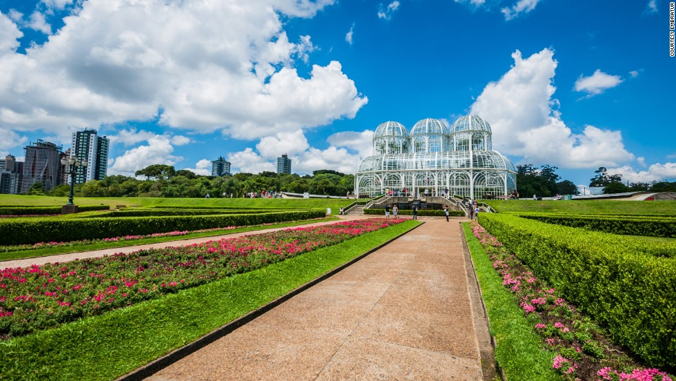 """The path leading to this impressive greenhouse -- flanked by thousands of flowers -- is just as beautiful as the plants within the glass and iron structure. At the Jardim das Sensacoes, visitors can be blindfolded to experience the textures and aromas of plants in a more concentrated and novel fashion.<a href=""""http://jardimbotanicocuritiba.com.br/"""" target=""""_blank""""><em><br />Botanical Garden of Curitiba<em></a></em>, Rua Engenheiro Ostoja Roguski, 690, Curitiba, Paraná; +55 41 3362 1800</em>"""