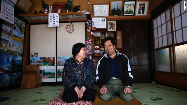 Toshio Koyama, 72, and his wife Kimiko, 69, who evacuated from the Miyakoji area of Tamura three years ago, smile after they returned to their home in Tamura, Fukushima prefecture April 1, 2014.