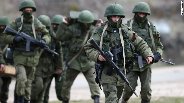 Russian military personnel move towards a Ukrainian military base on March 19, 2014 in Perevalnoe, Ukraine.