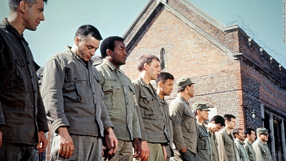 "Jim Brown (third from left) remains one of the greatest players in NFL history. After his nine-year pro career he turned to acting, with roles in ""The Dirty Dozen"" (pictured), ""The Running Man"" and ""Any Given Sunday."""