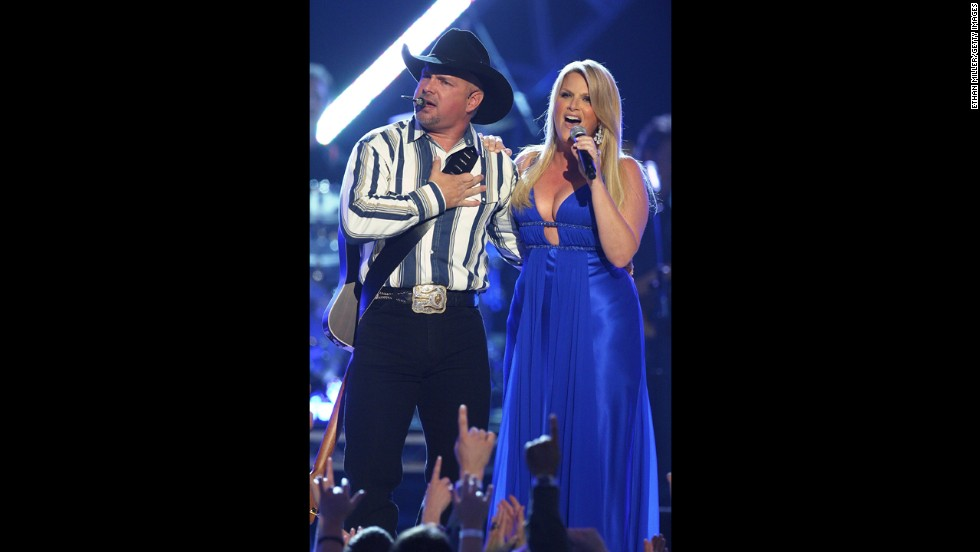 "<strong>Garth Brooks </strong>and<strong> Trisha Yearwood:</strong> Garth Brooks came out of a five-year retirement in a big way in 2005, when he proposed to his longtime friend and fellow country singer Trisha Yearwood in front of a crowd of 7,000. Both Brooks and Yearwood had been married in the years between their first meeting in 1987 and their eventual marriage, but as luck would have it, they both found themselves single at the same time and decided to give a romantic relationship a try. ""I've got to tell you, I never knew it could be like this,"" Brooks told Ellen DeGeneres last fall."
