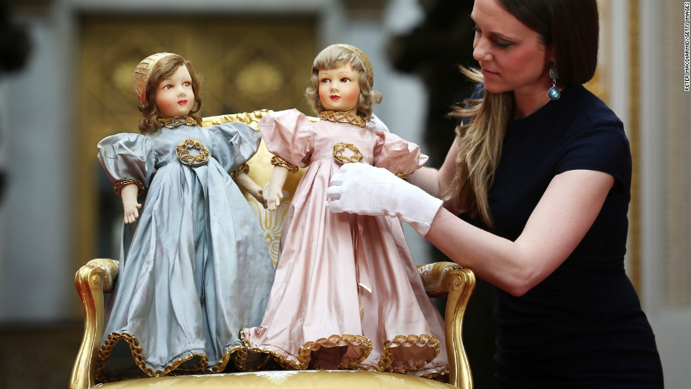Parisian dolls belonging to Queen Elizabeth II and Princess Margaret are adjusted on April 2 ahead of the Royal Childhood exhibition at Buckingham Palace in London. The exhibition, spanning more than 250 years, brings together a selection of toys and treasured family gifts and childhood outfits and will run from July 26 through September 28.