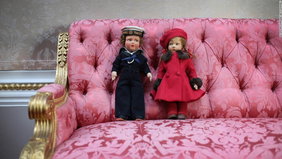 "A doll in a Navy uniform and ""Pamela"" in a red beret that belonged to Queen Elizabeth II are on display."