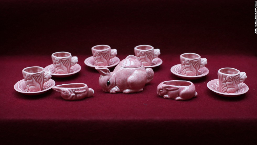 A pink tea set with a rabbit theme is displayed at Buckingham Palace.